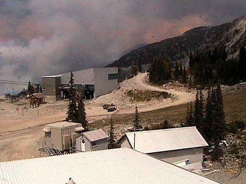 A tower camera shows the forest fire near the ski resort Thursday
